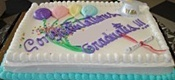 Graduation Cake with Congratulations Graduates written in icing