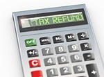 Image of calculator with text on the screen that reads Tax Refund